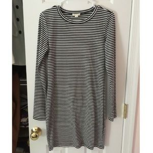 A soft, mid thigh, black and white stripped dress